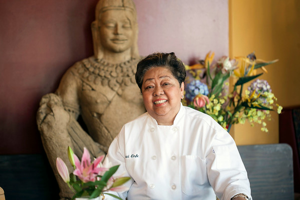 Thai Cafe Chef Chavantee Snow poses in the dining room.