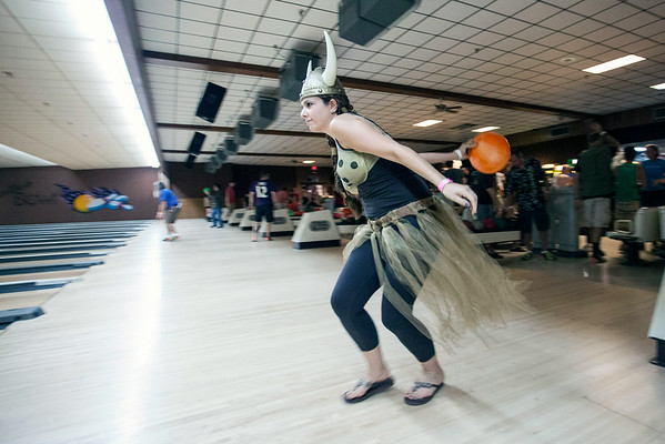 Jessica Knecht bowls while in full costume during the 13th Annual Lebowski Fest Bowling Party on Saturday night at Executive Strike on Phillips Lane.