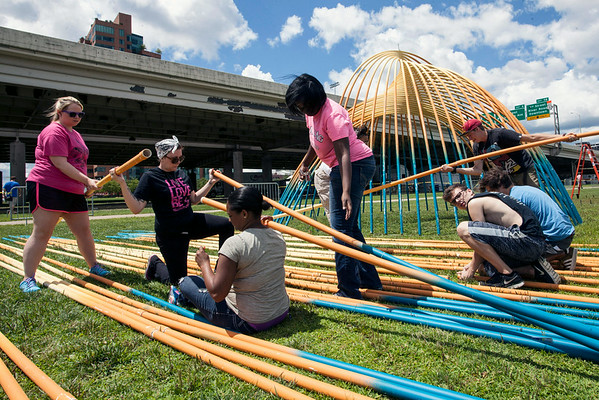 """Members of the group FR3FAL (pronounced Free-Fall) assemble shade areas they call """"shell-ters"""" on the edge of the great lawn on Wednesday afternoon."""
