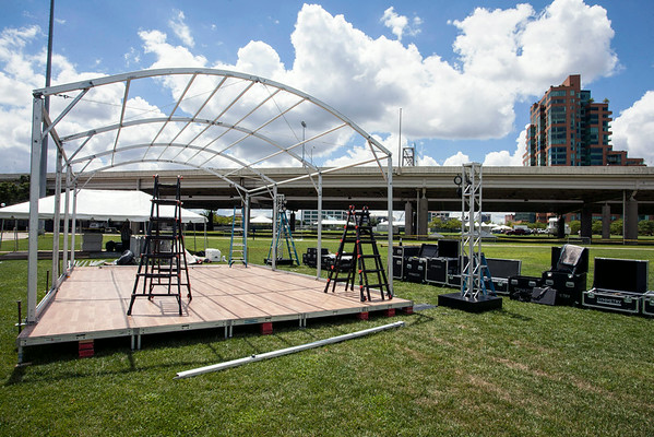 Skeletonized structures pepper the great lawn of the waterfront during the construction phase of this weekend's Forecastle Festival.