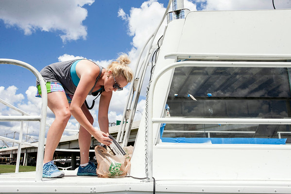 Mo McKnight-Howe puts the final touches on a party boat situated near the southern perimeter of the Forecastle Fest. The boat will be painted by various artists during the three-day festival.