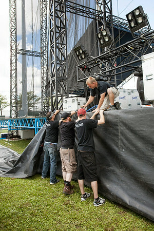 Technicians and crew members take the high and low ground during the final push to assemble, wire, light, and secure the many stages and rigs that comprise the Forecastle infrastructure.