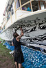 Artist Vincent Kochert goes to work on the party yacht.