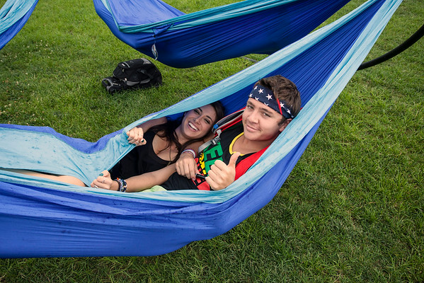 Billy Lain and Kat Manouchettki seek refuge from the rain in a hammock together.