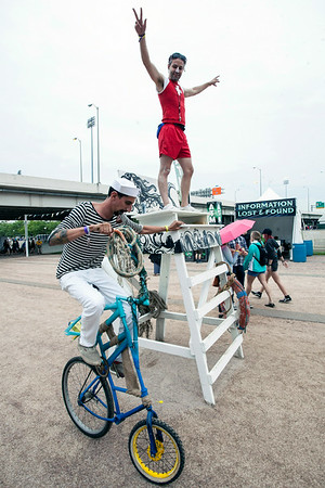 Mitch Hoffman, and his circus-style bike, work the entrance with lifeguard Mike Foster presenting a surreal and festive atmosphere for those arriving to Forecastle.