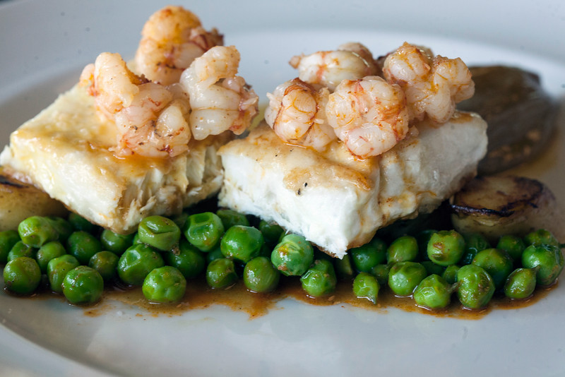 """""""Seared east coast halibut with English peas sauteed in chorizo cream, shallot confit and true rock shrimp (with) saffron poached fingerling potatoes"""" is how Chef Shawn Ward describes this menu item at The Brewery."""
