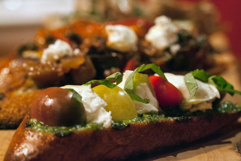 The Crostinis at The Place Downstairs boast a number of ingredients including arugula, pecorino, preserved tomatoes, caramelized walnuts, cantaloupe, olive oil and aged balsamic with the promise of an explosion of flavor in each variety.