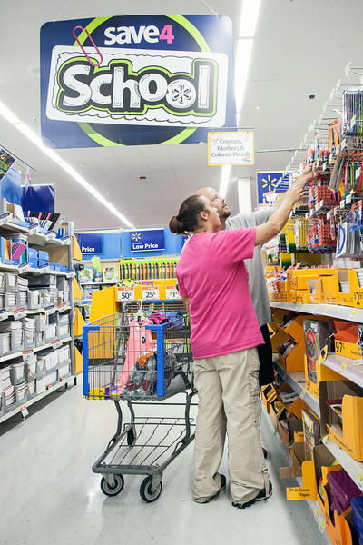 James Hoffman and Jennifer Burks take a closer look as they seek out good prices during a back to school shopping trip at WalMart.