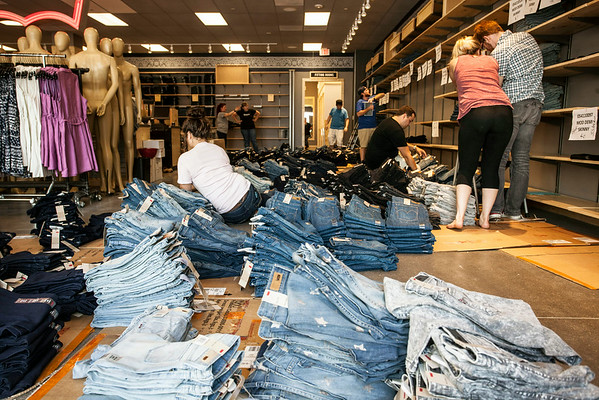 The Levi's Outlet was a landscape of denim stacks, scattered employees and corralled naked mannequins.