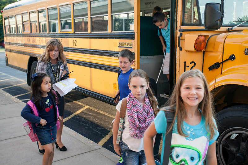 School administrators greeted each bus to insure that students started the new year in the right place.