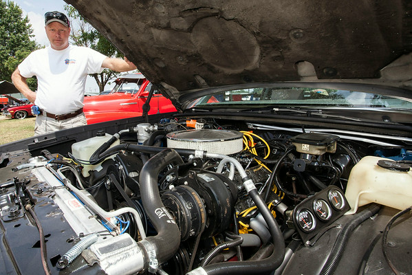 """Charles Johnson, Jr shows off the 350hp engine in his 1984 Monty Carlo """"SS""""."""