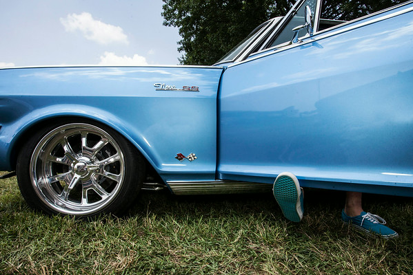 """Adam Hardesty drops his family's 1964 Chevrolet Nova """"SS"""" to its lowest suspension just inches above the lawn."""