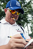 Greg Busby, a Henderson, KY native and childhood friend of PGA golfer Brian Norman, follows his friend and keeps notes on his performance.