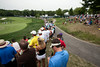 Fans clustered under trees and across the hilly lawn watched J.B. Holmes make his way up the #9 fairway on Thursday.
