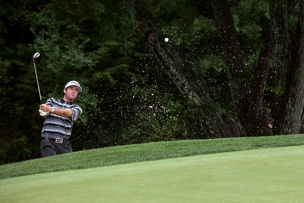 Bubba Watson gets himself out of the trap on the 4th hole.