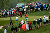 The trio of J.B. Holmes, Luke Donald and Francesco Molinari finish up the 12th hole in a light rain on Friday morning at Valhalla.