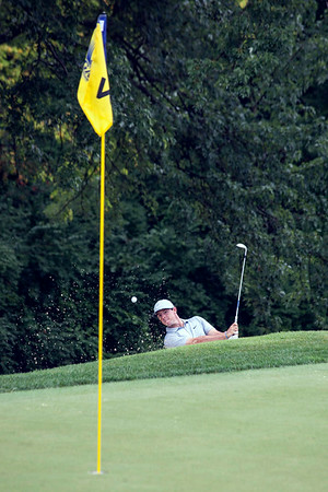 Rory McIlroy takes the ball from sand to green on the 4th hole at Valhalla on Friday.