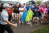 Fans watch in wonder as leader Rory McIlroy heads to the 7th hole at Valhalla on Friday.