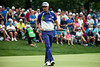 Rickie Fowler sizes up the situation on a short putt.