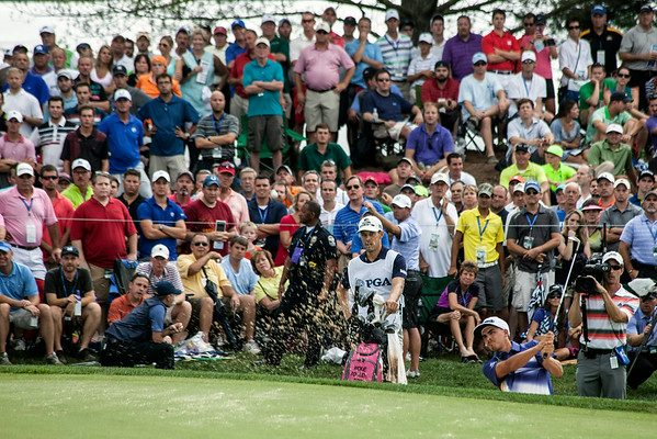 Rickie Fowler makes his way out of a bunker with no ill effect on his score.