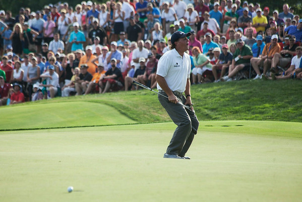 Phil Mickelson reacts to his missed putt on the 18th hole.