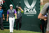 Rory McIlroy arrives at the 1st hole on the final round of the championship.