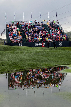 A brief rain delay during the final round of the 2014 PGA Championship at Valhalla on Sunday stopped the action but made for colorful photo opps.