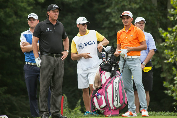 Phil Mickelson and Rickie Fowler wait to get their next drive.
