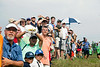 The crowds watch to see where Rory McIlroy's shot lands from a fairway hit.