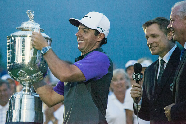 Rory McIlroy accepts the trophy for winning the 2014 PGA Championship at Valhalla on Sunday.