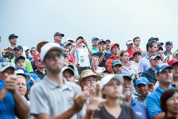 The crowd around the 18th hole swelled as the leaders approached.