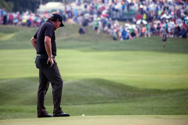 Phil Mickelson stares at his ball on the 18th hole at Valhalla during the final round of the 2014 PGA Championship.
