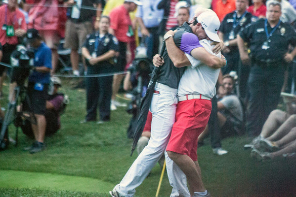 Rory McIlroy embraces his father Gerry upon winning the 2014 PGA Championship at Valhalla on Sunday.