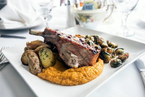 Boasting an impressive size, the Pork Chop is maple Bourbon glazed and smoked gouda stuffed with sweet potato mousse, fingerling potatoes, and crispy brussels sprouts. 8/28/14