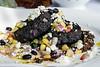 The Black Bean Cakes are a mix of black bean hummus, chipotle aioli, corn salsa, feta, and avocado oil. 8/28/14