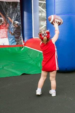 Young fans tried their hand at completing a football pass during tailgating.