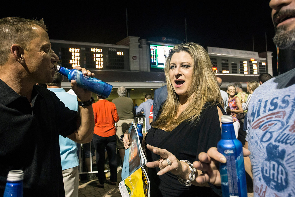 Shannon Saylor Meenach thinks she knows who will win the next race during Downs After Dark on Friday. 9/5/14