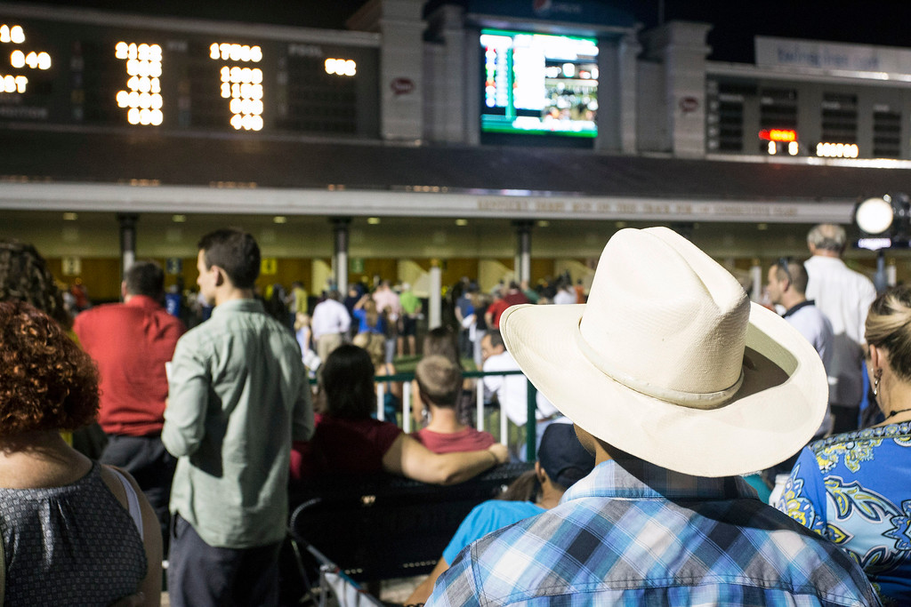 Fans enjoy the open atmosphere under clear night skies at historic Churchill Downs during another installment of Downs After Dark. 9/5/14
