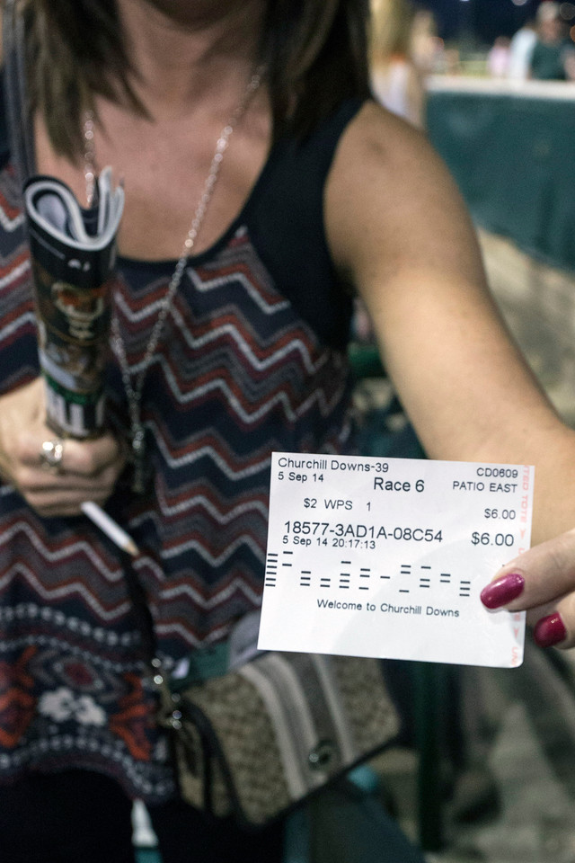 Lisa McConahy shows off her winning ticket during Downs After Dark. 9/5/14
