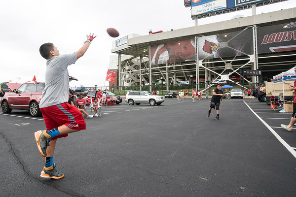 Lucas Trautwein and Heath Pennington toss around a football as they wait for the game to begin. 9/6/14