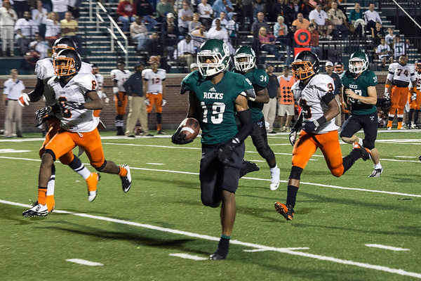 Trinity's Donald Brooks races past Cocoa defenders in the second half for a touchdown. 9/19/14