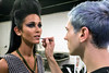 Make-up artist James Ryan Coomer applies some last minute touches to model Tina Gashi before the runway show. 10/9/14