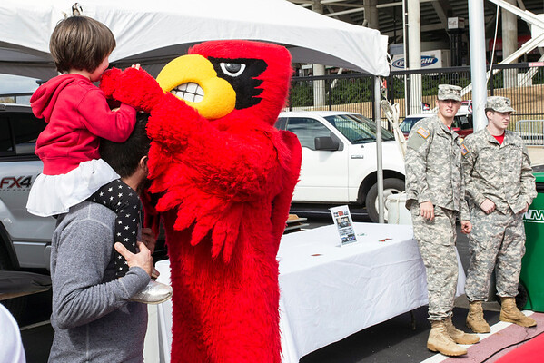 The Cards mascot works the crowd during tailgating at Papa John's Stadium on Saturday. 10/18/14