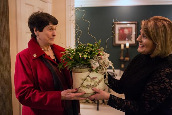 Dinner guest Bianca Cristofoli arrives with a gift in hand for host Karen Shore. 11/9/14