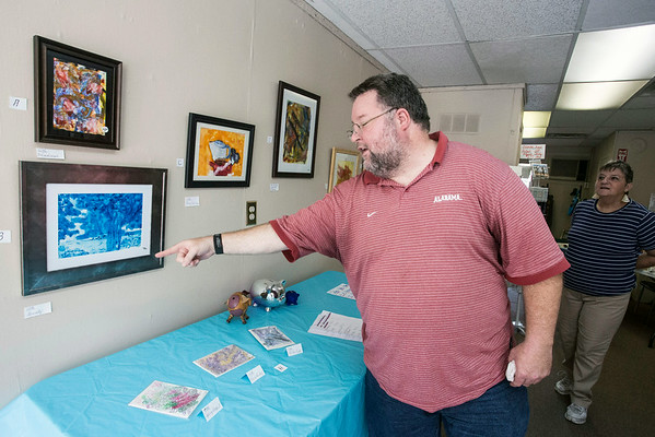 Kevin Hooks proudly discusses his work which is currently on display at the Purple Pig on Spring Street in Jeffersonville.
