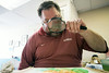 Artist Kevin Hooks uses a magnifying glass in his process to overcome the effects of an injury sustained in combat.