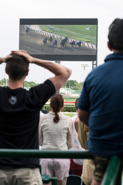 The crowd at Churchill Downs, watching on the giant screen, reacts to the outcome of the Belmont Stakes with mixed emotion as California Chrome comes up short in his claim for the Triple Crown.