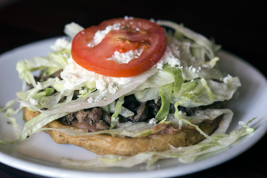 The sopes at El Mariachi come with your choice of meat and are topped with beans, lettuce, sour cream, fresco cheese and a tomato.