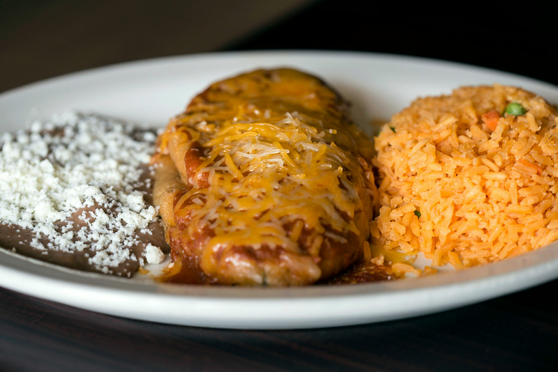 The enchiladas at El Mariachi come with rice and beans topped with fresco cheese.