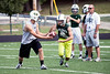 Floyd Central quarterback Colton Kimm hands the ball to running back Gaige Klingsmith during practice.